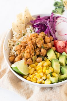 This vegan, gluten-free chickpea taco buddha bowl is subtly spiced, packed with flavour and unbelievably satisfying via @ExSloth | ExSloth.com