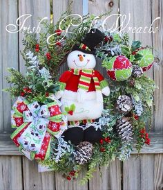 A personal favorite from my Etsy shop https://www.etsy.com/listing/476322738/cheerful-snowman-wreath-lime-and-red