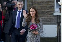 Kate stopped to chat to two youngsters who proudly presented her with flowers after her visit to Hope House. 2.19.13.