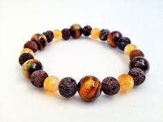 Tiger's Eye, Citrine and Lava- unisex bracelet  Rub a drop of essential oil on the lava stone and it acts as a personal diffuser for about 3 days. [ LavHa.com ]
