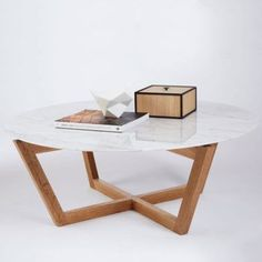 This modern designer round marble top coffee table and accent table is a combination of white Italian Carrara marble on a solid oak timber base.