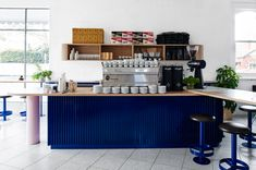 drawing influence from west coast america and wes anderson films, this cafe by techne in melbourne aims to provide a lively space for coffee drinkers.