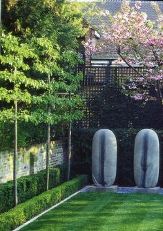 espaliered trees and sculpture