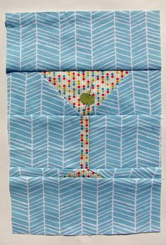 I designed this block specifically for the back of Amanda's Swanky Squares quilt (because what's a Mad Men themed quilt without a marti...