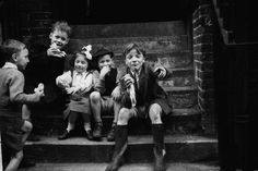 Children sit on steps in an East End street 1954 | Museum of London