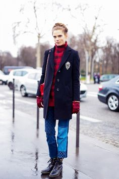 Caroline Brasch Neilsen mixes her crest blazer with patchwork jeans and lace-up boots.
