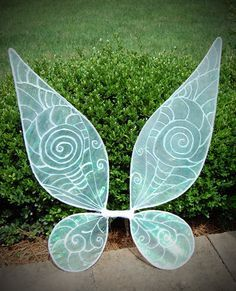 These wings have changed quite a bit since this pair...see https://www.etsy.com/listing/264787124/to-scale-adult-tinkerbell-or-periwinkle Periwinkle fairy costume; fairy wings; fairy tutu. By Enchanted Ever After.
