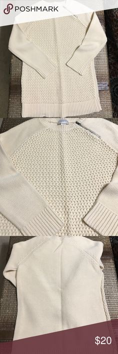 Loft sweater Cream, Loft sweater with a side zipper. Pattern on front is tiny holes, a camisole is needed underneath. Back of the sweater is solid. Great condition, worn twice. LOFT Sweaters Crew & Scoop Necks