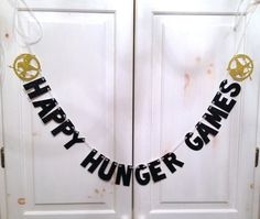 "Who else is getting excited for Catching Fire??? Check out our ""Happy Hunger Games"" Glitter Banner on Etsy!"