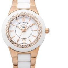 Aquaswiss women's watch, NWT, was $1495 This gorgeous ceramic watch from Aquaswiss is part of their Sea Star collection.  Originally $1495, it will arrive new in box with all warranty paperwork.  Colors are white and rose gold.  Absolutely beautiful, great colors for summer! Aquaswiss Accessories Watches