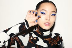 Xiao Wen Ju. Blue eyeliner and nails