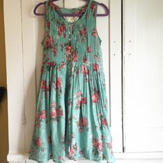 Modcloth ADORABLE Vintage rose patterned dress. Sheer, flowy teal dress with vintage rose pattern. Slightly Sheer material, skirt is fully lined. Button and pleating details up the front. ModCloth Dresses