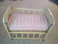 """Yellow Metal Vintage Amsco """"Doll-E-Crib"""" Bed Adjustable Side Rail wooden casters. Bed Measurements: L 25 & one-fourth, W 15 & one-fourth, H 21 & one fourth. Bed Measurements, Doll Furniture, Crib Bedding, Cribs, Mattress, 1950s, Dolls, Metal, Table"""