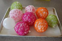 Wrap yarn that has been dipped into glue around a balloon & then pop. Too cool!