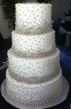 Thousands of little silver dragees adorned this wedding cake. My phone camera wasn& able to do this cake justice, so I& excited to see the photographers photos. It took me just over 9 hours to individually attach each and every dragee! Bling Wedding Cakes, Bling Cakes, Round Wedding Cakes, Elegant Wedding Cakes, Beautiful Wedding Cakes, Wedding Cake Designs, Fancy Cakes, Beautiful Cakes, Amazing Cakes
