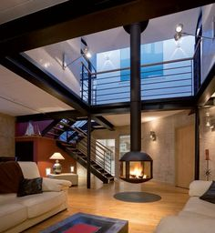 Modern Home With A Suspended Circular Fireplace