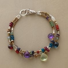 """SAMBA BRACELET -- Brass and sterling beads set up the backbeat while faceted drops of sapphire, amethyst and apatite shimmer in a mesmerizing rhythm with other semiprecious stones. Sterling silver clasp. USA. Exclusive. 7-1/2""""L."""