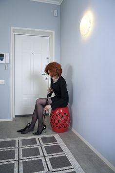 red garden stool in