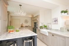 Hand-painted kitchen with granite work surfaces. http://www.myfathersheart.com/hand-painted-kitchen-with-granite-work-surfaces