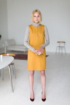what a great way to use summer dresses in winter; just put a thin sweater underneath.