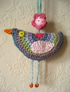Birdie Decoration Pattern by Attic 24: This is my pattern/tutorial for a hanging Birdie Decoration. A completely useless object of course, but very cute all the same. It's an easy project to make, great for using up odds and ends of yarn and can be used in all sorts of ways to bring a little good cheer.