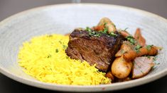 For the upcoming Jewish holidays of Rosh Hashanah and Yom Kippur, New Orleans chef Alon Shaya provides a recipe for mouthwatering spiced short ribs and a Moroccan carrot salad. Wine Spectator recommends 12 kosher red wines to pair with this kosher feast.