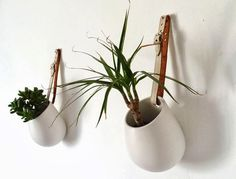 use Ikea Asker containers and old leather beltst to make hanging plant pots for bathrooms or balcony.  From Poppytalk: 20 Best IKEA Hacks of 2013