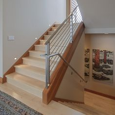 stair rail ideas staircase in Staircase Contemporary with light wood staircase dark wood baseboard Interior Stair Railing, Modern Stair Railing, Stair Banister, Stair Railing Design, Wood Staircase, Modern Stairs, Banisters, Banister Ideas, Railings