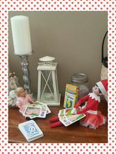 Elf on the shelf playing go fish with mini American girl doll
