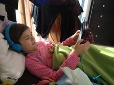 Parent-teacher teamwork is the name of the game! Success stories and back to school resources, cross-posted from our blog board, at http://bookshareblog.wpengine.com/2015/08/bookshare-parents-and-teachers-team-up-for-back-to-school (Photo: Lilly reading her iPad in bed with headphones)