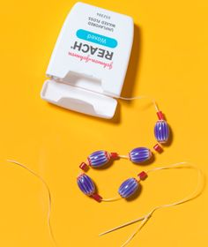 Dental Floss as Necklace String  Rethread the beads of a broken necklace. Slide beads onto a piece of floss one by one, leaving a few extra inches of loose string. Tie the ends to the jewelry findings from the original necklace and knot several times.
