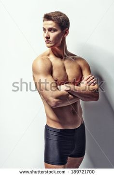 Portrait of a young muscular man in underwear looking away with arms crossed against white wall Action Pose Reference, Human Poses Reference, Pose Reference Photo, Body Reference, Action Poses, Anatomy Reference, Inspiration Art, Anatomy Poses, Arms Crossed