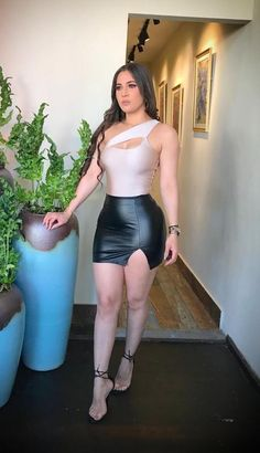 Product Detail: BLACK-LEATHER-SKIRT-SIDE SLIT Fabric: 74% RAYON-22% NYLON-4% SPANDEX Made In: USA Sexy Women, Women Wear, Ladies Wear, Black Leather Mini Skirt, Girls In Mini Skirts, Hot Cheerleaders, Leather Dresses, Autumn Fashion, Bodycon Dress