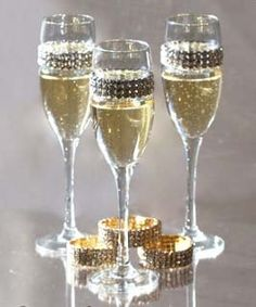 Champagne flutes with removable and interchangeable bling bracelets. wedding