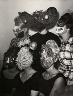 Denise Bellon -Gathering of Surrealists group with mask wearing guests  (france | ca.1950s-1960s)