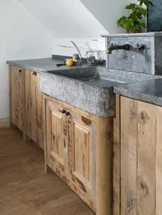 http://www.GraphicDesignNYC.net Kitchens | Dirk Cousaert  Too cool. Soap stone counter tops and sink, natural pine finish.