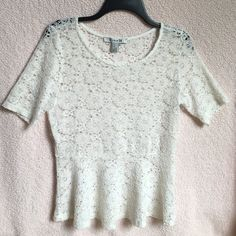 Forever 21 short sleeve lace top Forever 21 short sleeve top. White lace with a shimmer to it. Size M. Has a pretty ruffle (peplum) at bottom. Very pretty & Excellent condition. Would look great with a tank top underneath, skirt, shorts & jeans. Perfect top for the summer! Forever 21 Tops Blouses
