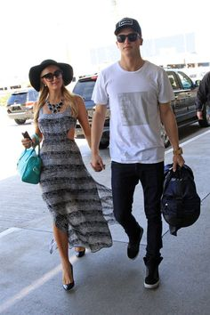 Paris Hilton and her boyfriend River Viiperi head into LAX
