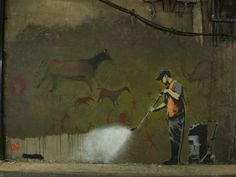 I love when street art (or art in general) has such meaning!! Must be Banksy