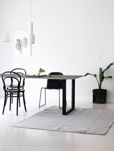 a_merry_mishap_dining_room_5 minimalist dining area lighting flooring décor simple lines uncluttered