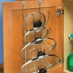 Put the inside of your cabinet doors to work, too, storing pot lids or hiding your trash can. | 23 Clever Things That Will Actually Organize Your Tiny Apartment
