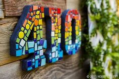 Bare wood accents are great surfaces for mosaic work— they can be turned into everything from funky house numbers to a tailor-made monogram.