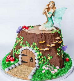 Fairy garden tree stump house cake