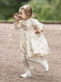 Swedish Princess Estelle examines a piece of flower petals she found during her mommy dearest  birthday celebration in July 2014
