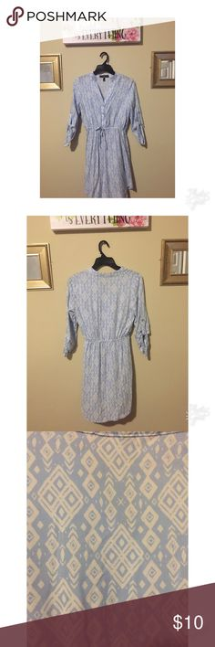 Flows Patterned Dress Never worn in. This dress is in good condition. Has v neck button down with elastic around the waist . Has blue and white patterns . Dresses Mini