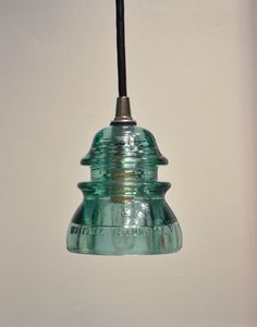 We love old telephone glass insulators. Our dad was a lineman for 37 years and collected many. This glass insulator light pendant is cool!