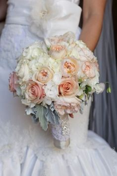 Vintage glam bouquet with lace handle detail featuring blush tones with soft grey accents. Dusty miller, garden roses, sweet peas, and other seasonal flowers. Created by Nancy Liu Chin.