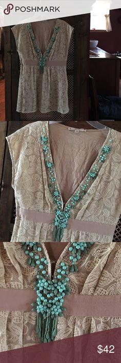 Gorgeous Nanette Lepore lace  blouse This is excellent condition, it has a flower lace design with turquoise beads in the front, it's a V next  very low. Nanette Lepore Tops Blouses