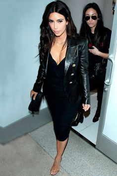 Kim Kardashian Works An LBD With A Cool Leather Blazer At LAX Airport In LA, 2014