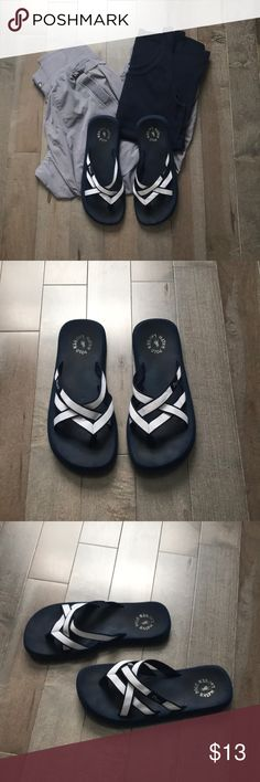 Ralph Lauren Sandals Gently used Navy blue and light blue thong sandals. Signs of wear shown in pictures, price reflects condition. These are super comfortable! Polo by Ralph Lauren Shoes Sandals